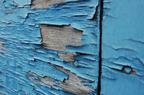 Peeling paint, signs of water damage.